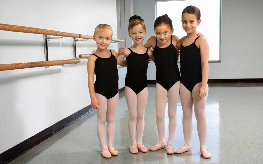 cute kids posing wearing leotards for girls