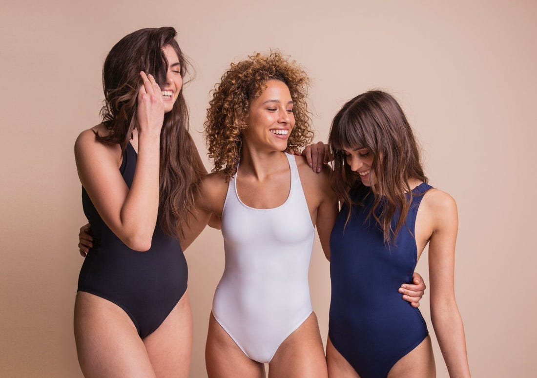 happy girls wearing bathing suit leotards for girls
