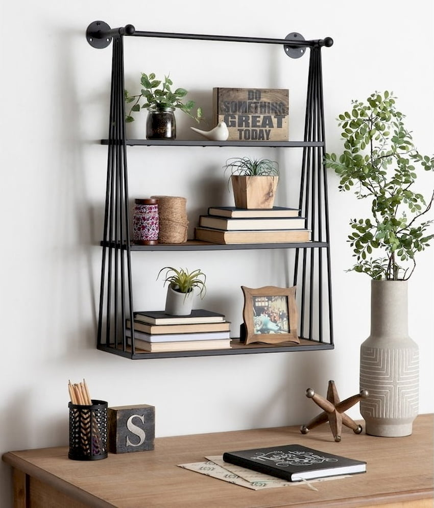 modern wall hanging shelf with books and plants