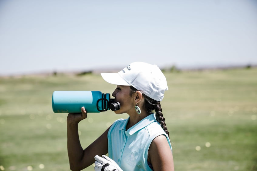 woman-drinking-from-eco-friendly-bottle