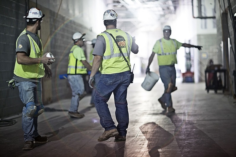 workers wearing protective electric gear