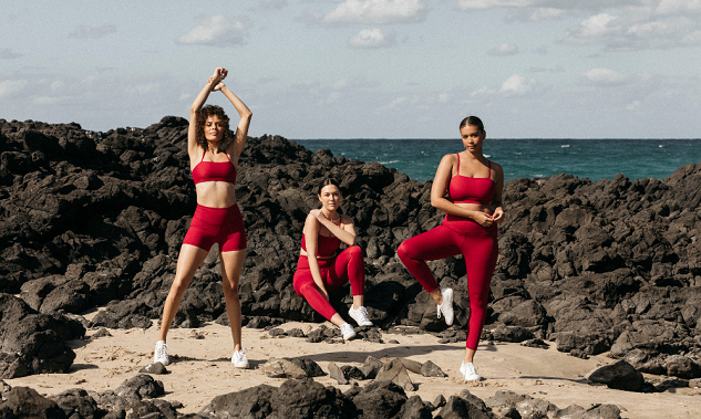 girls on beach wearing red fitness clothes