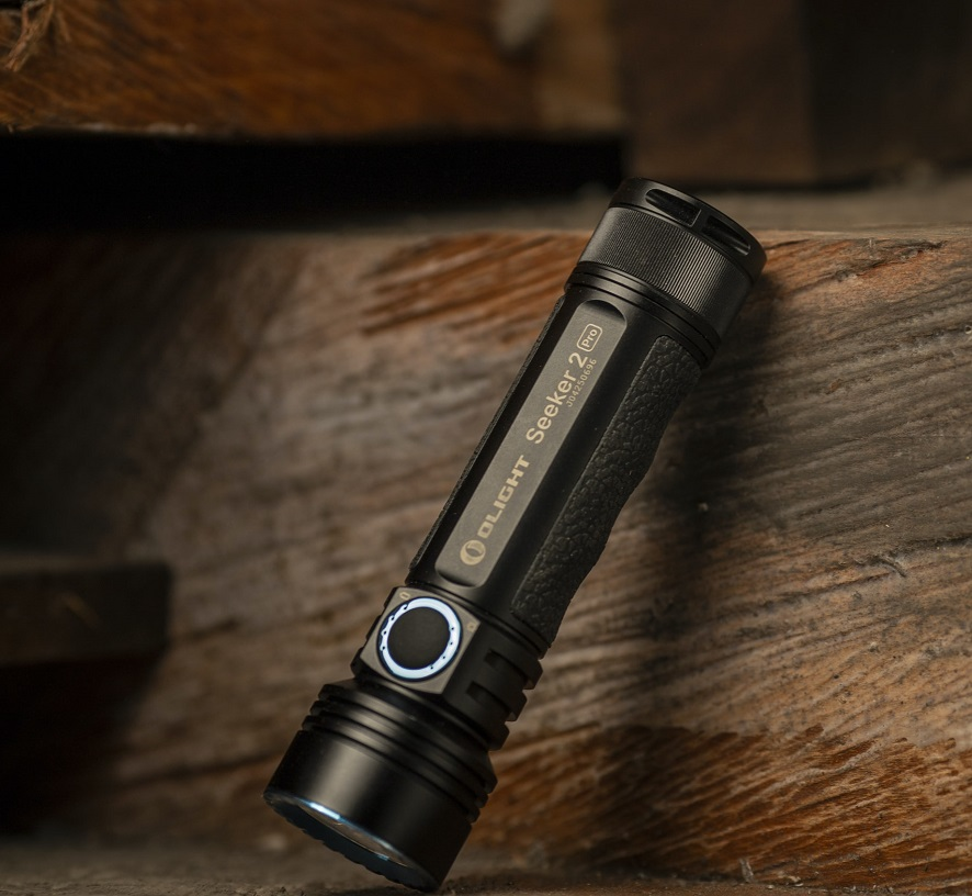 picture of black flashlight on a wooden background